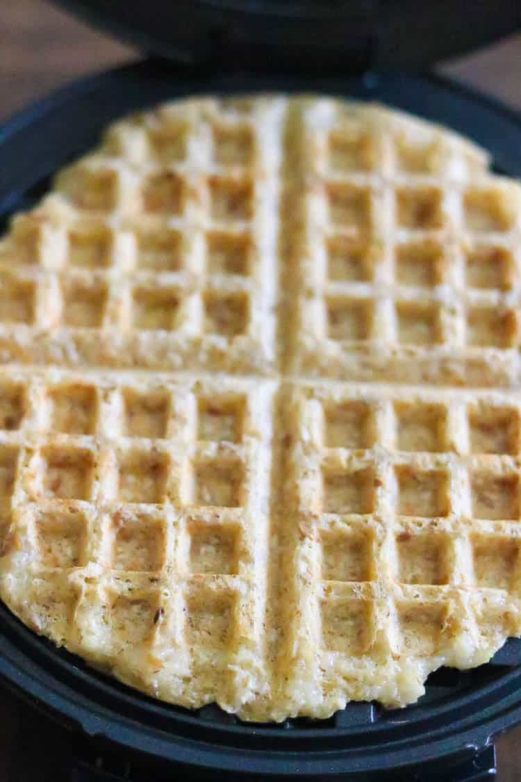 overhead shot of lightly browned vegan waffle in opened waffle iron