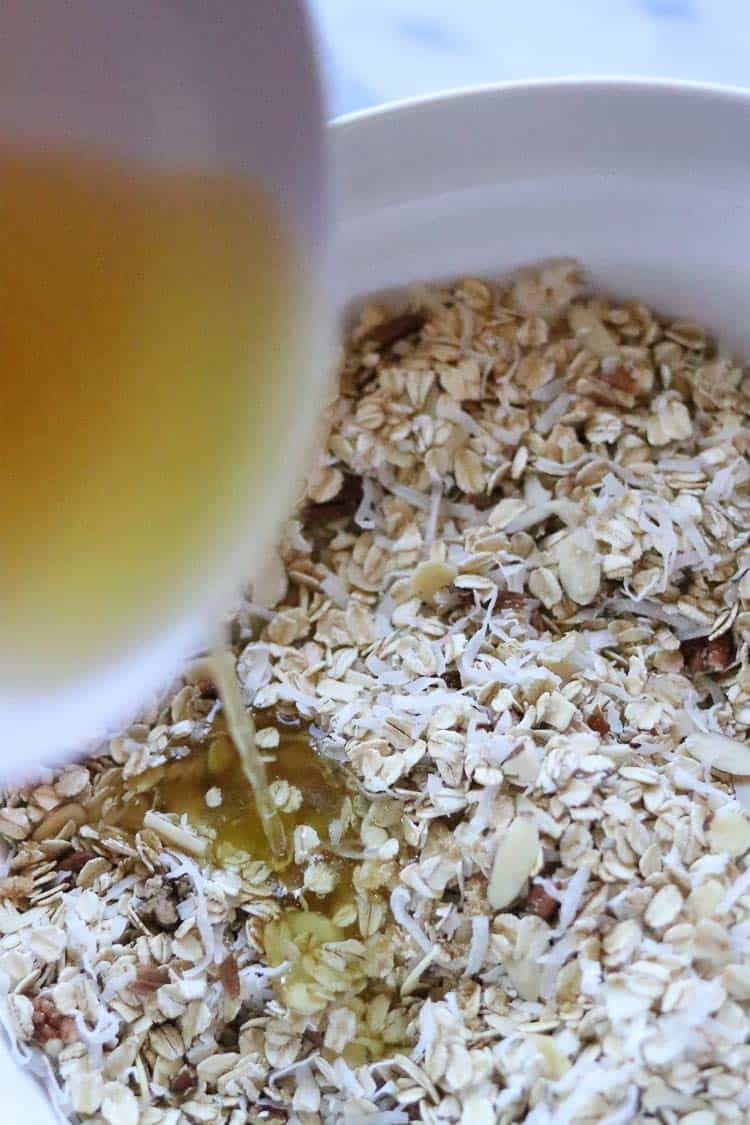 agave and oil being poured onto vegan granola