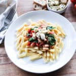Pasta with Tomato, Spinach, and White Bean Sauce with Tofu Feta Topping