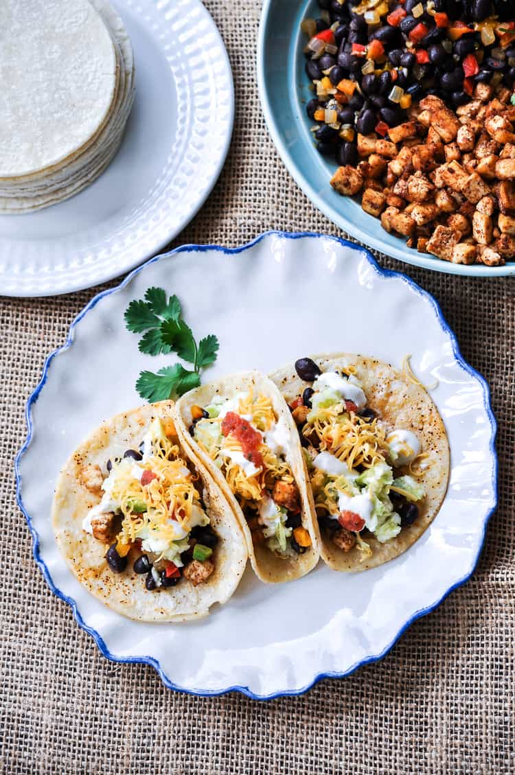 The Vegan Baked Tofu Tacos of your dreams! With black beans and cabbage slaw. https://www.veganblueberry.com