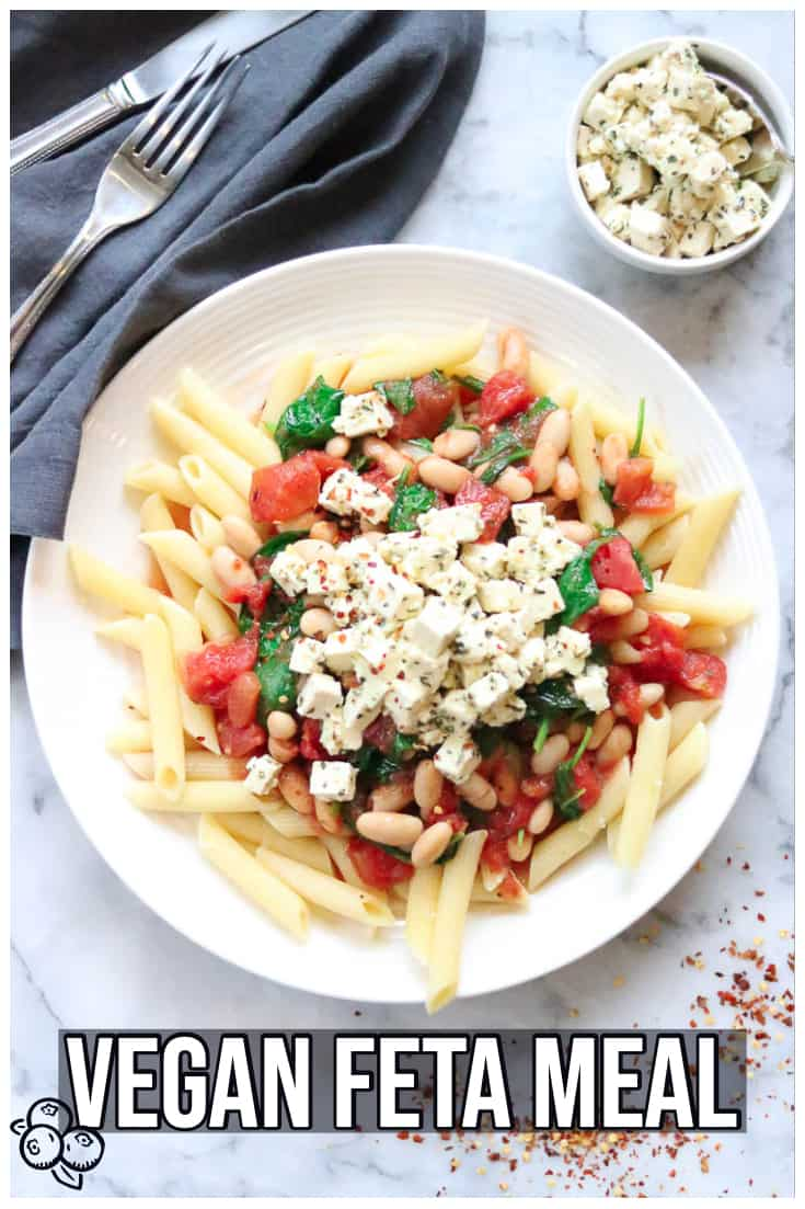 This amazing pasta meal is made in thirty minutes or less and is packed with delicious spinach, protein-rich Cannellini beans, and topped with feta-style marinated tofu!!  #veganfeta #veganpasta