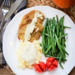Tender Vegan Steaks Plated with Mashed Potatoes and Green Beans