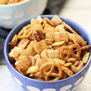 overhead closeup shot of vegan chex mix in a blue and white bowl