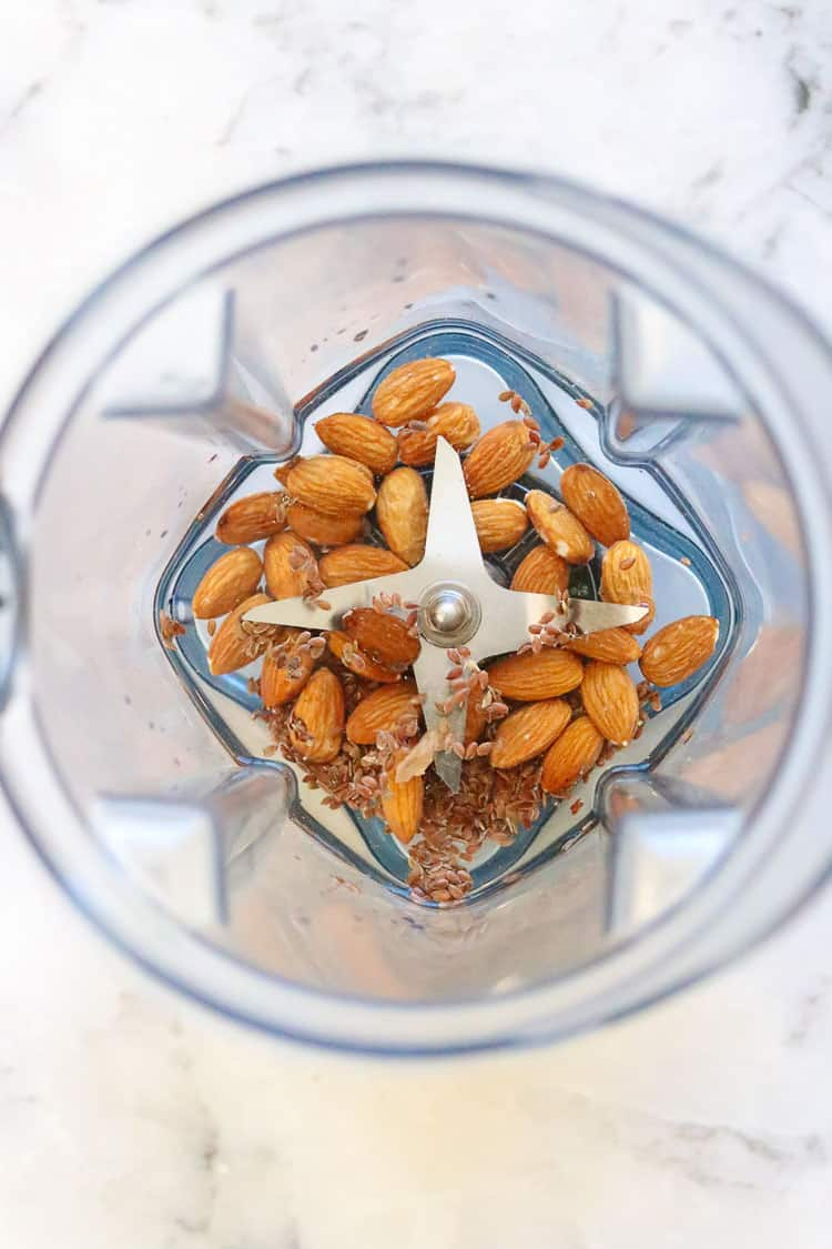overhead shot of almonds, flaxseed, and water in blender