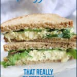 Pin image graphic with text shot of tofu egg salad sandwich cut and stacked.