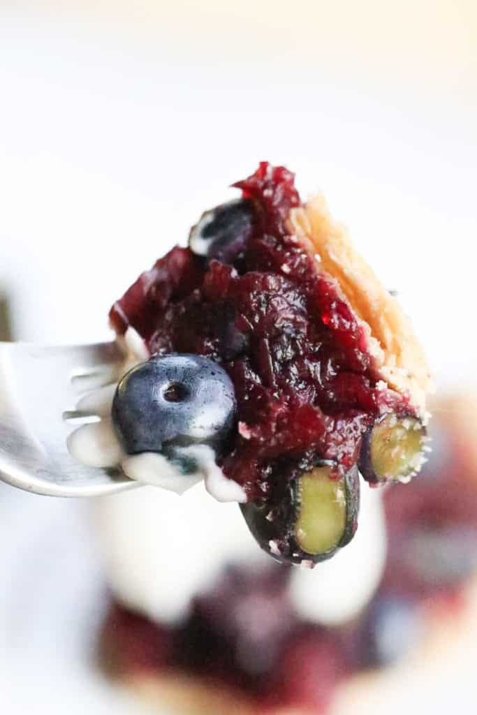 Closeup shot of a bite of Easy Blueberry Pie on a fork
