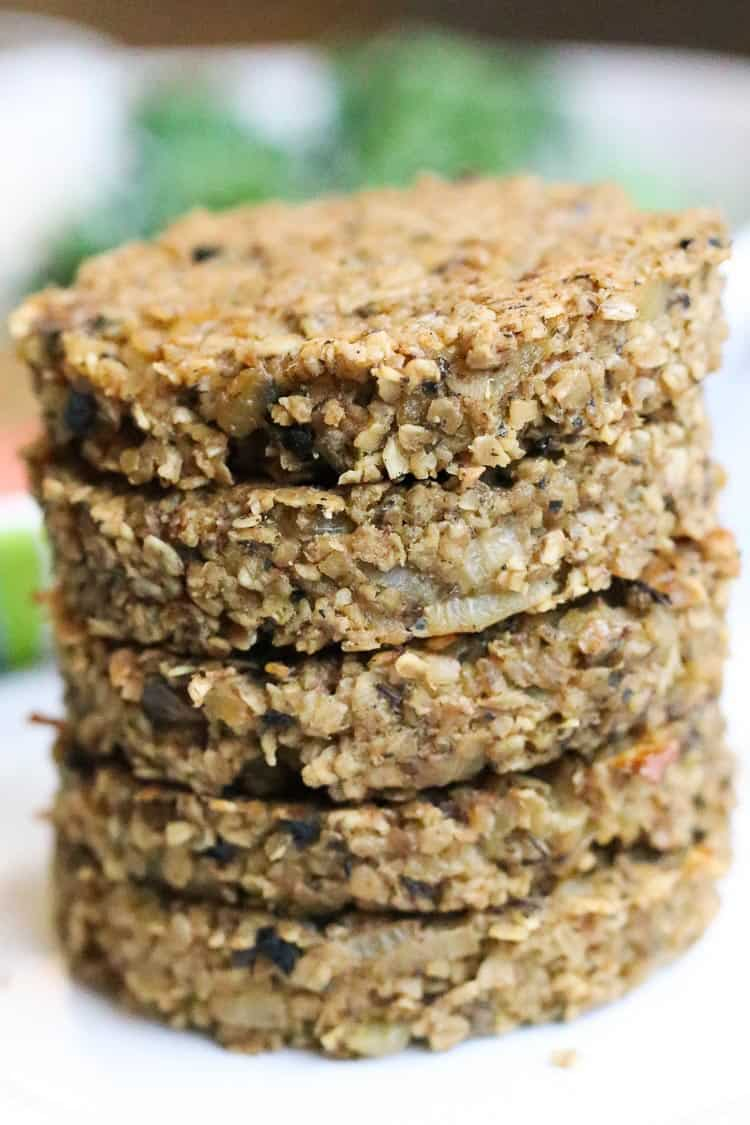 side shot of stacked vegan oatmeal burgers