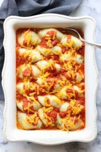 Overhead shot of vegan stuffed shells in a white baking dish