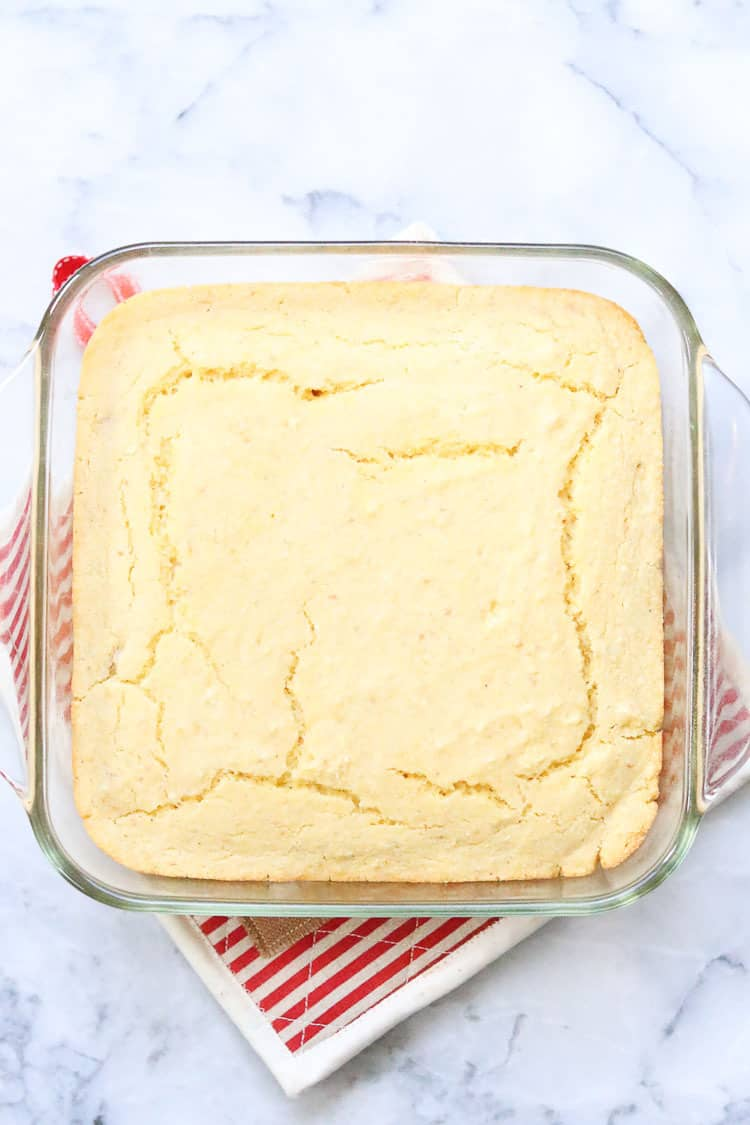 overhead view of baked vegan cornbread in clear baking dish