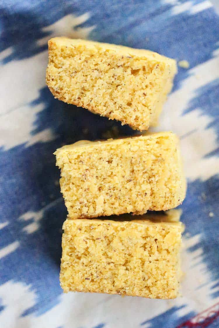 overhead view of vegan cornbread squares laid on a blue and white napkin