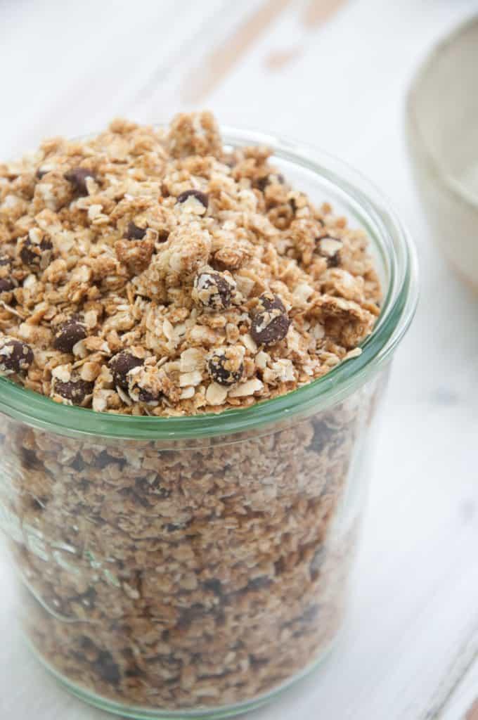 side shot of peanut butter granola in a clear jar