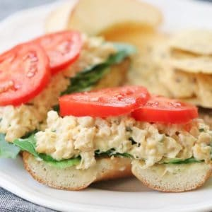side closeup shot of chickpea salad sandwich with tomato