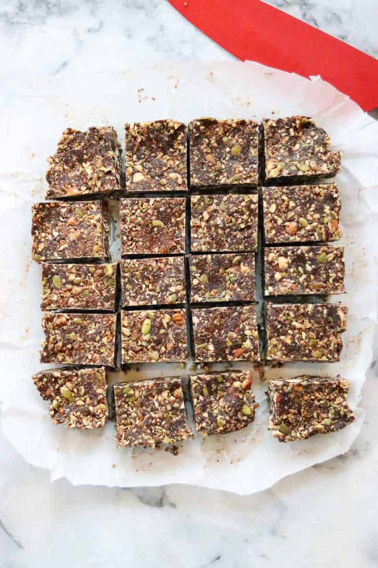 overhead view of gingersnap bars cut up on top of parchment paper