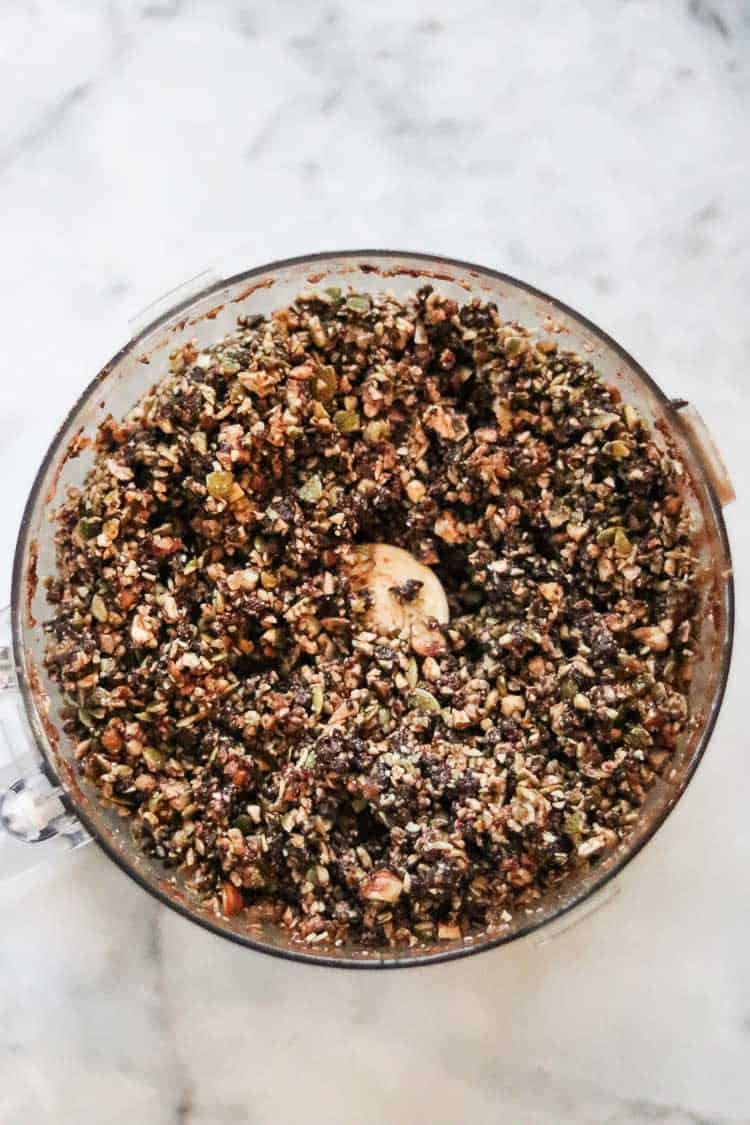 overhead view of chopped mixture for gingersnap bars in food processor bowl