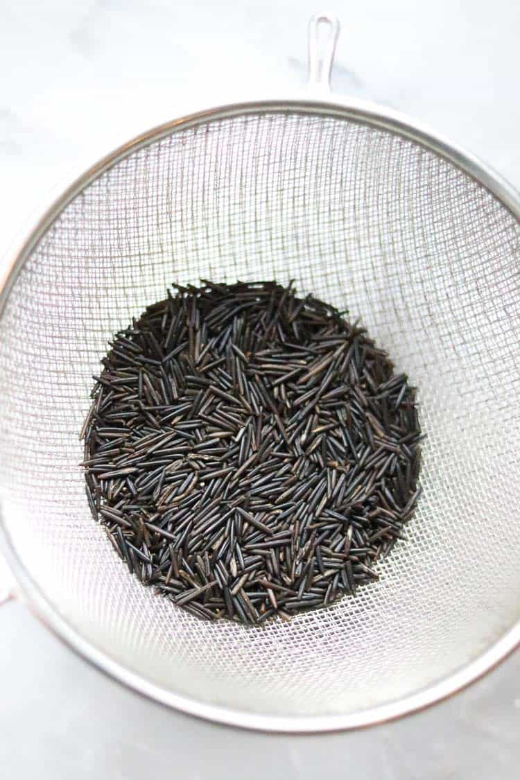 overhead shot of wild rice in a colander