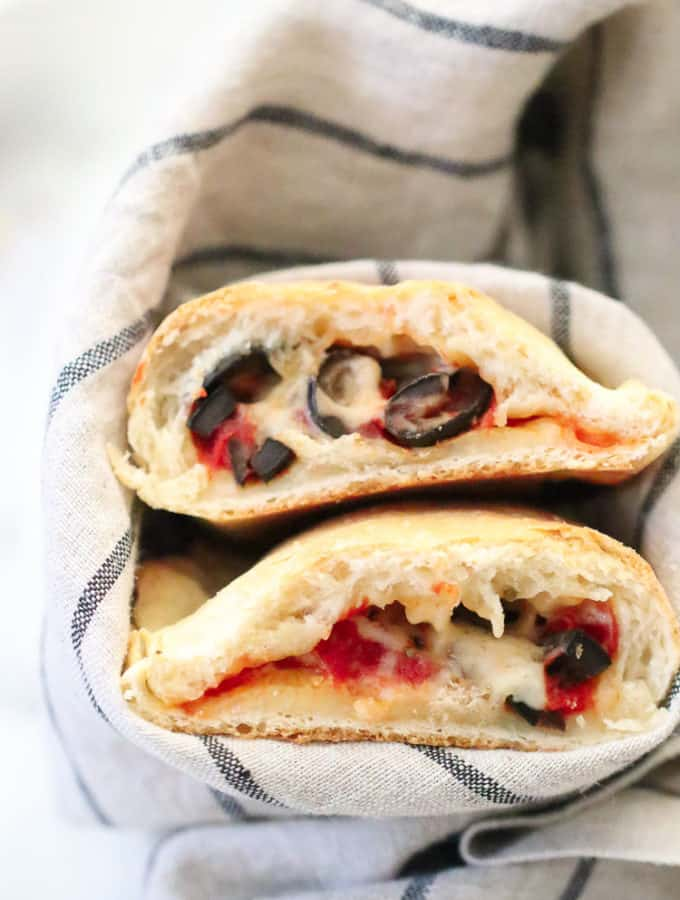 overhead shot of vegan calzones turned with open face
