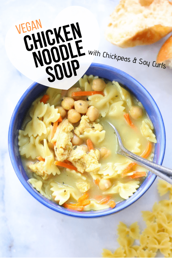 overhead shot of vegan chicken noodle soup in a blue bowl with text overlay for pinterest graphic