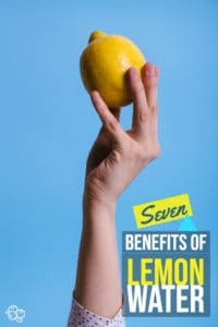 side shot of hand holding a lemon for pinterest graphic