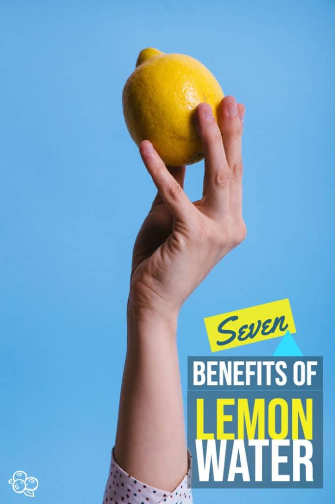 side shot of hand holding a lemon for pinterest graphic