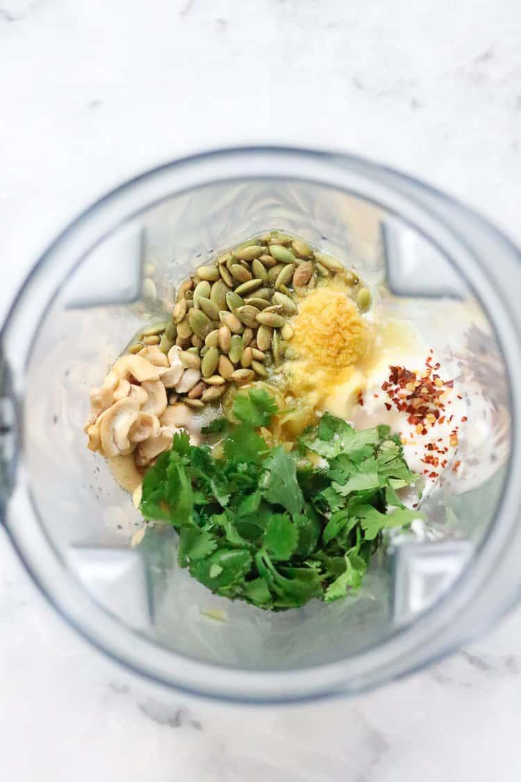 overhead shot of all ingredients for vegan caesar dressing in blender
