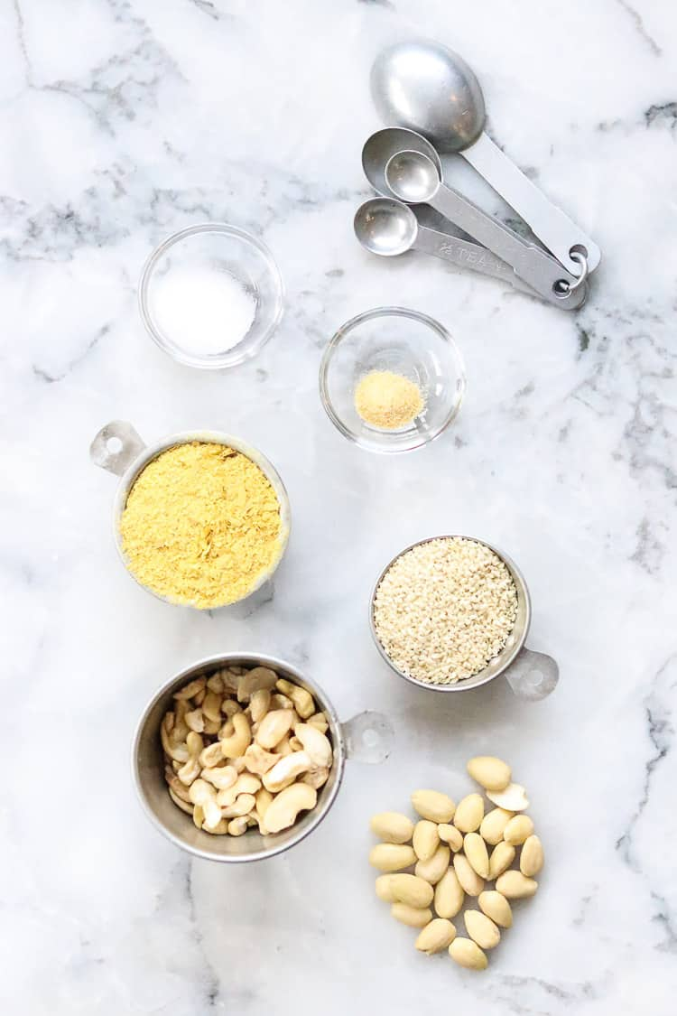 overhead shot of ingredients for vegan parmesan cheese arranged on marble background