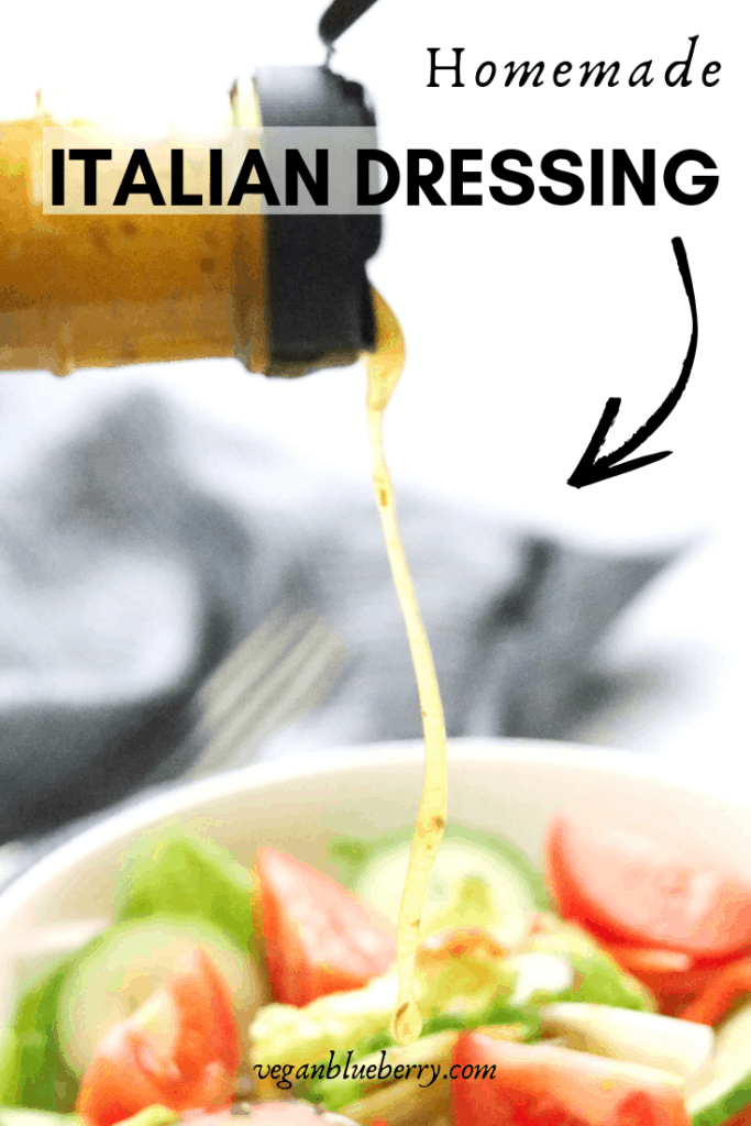 side shot of homemade Italian dressing being poured onto salad with text overlay