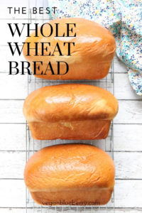 overhead shot of vegan whole wheat bread with text overlay for pinterest