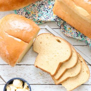 overhead shot of loaves of whole wheat bread with sliced bread and butter