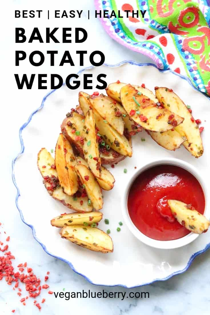 overhead shot of baked potato wedges on a white plate with text overlay for Pinterest