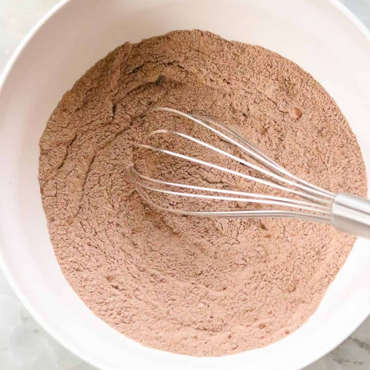 Dry ingredients for brownies in a bowl.