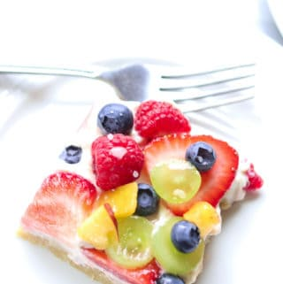 overhead closeup photo of a square slice of vegan fruit pizza