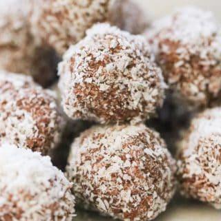 side shot of piled up vegan coconut balls