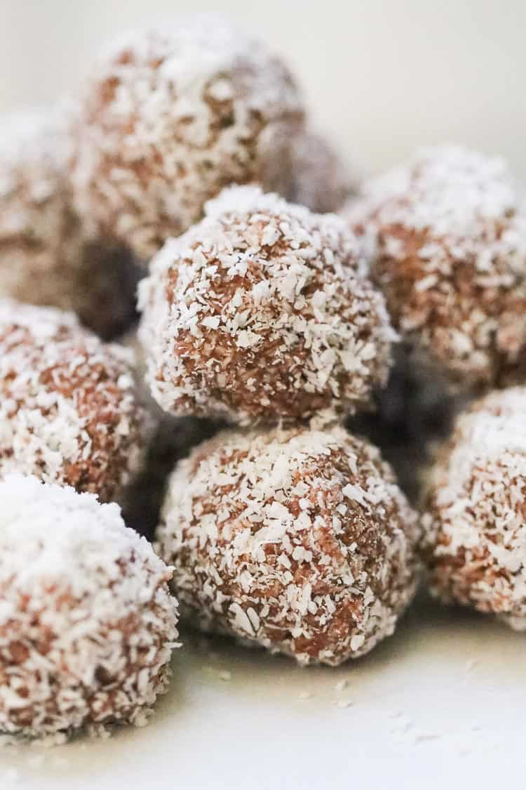 side closeup shot of stacked vegan coconut balls