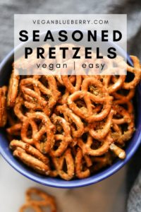 overhead photo of seasoned pretzels in a blue bowl with text overlay for pinterest