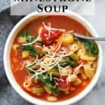 closeup overhead shot of bowl of vegan minestrone soup with text overlay for pinterest
