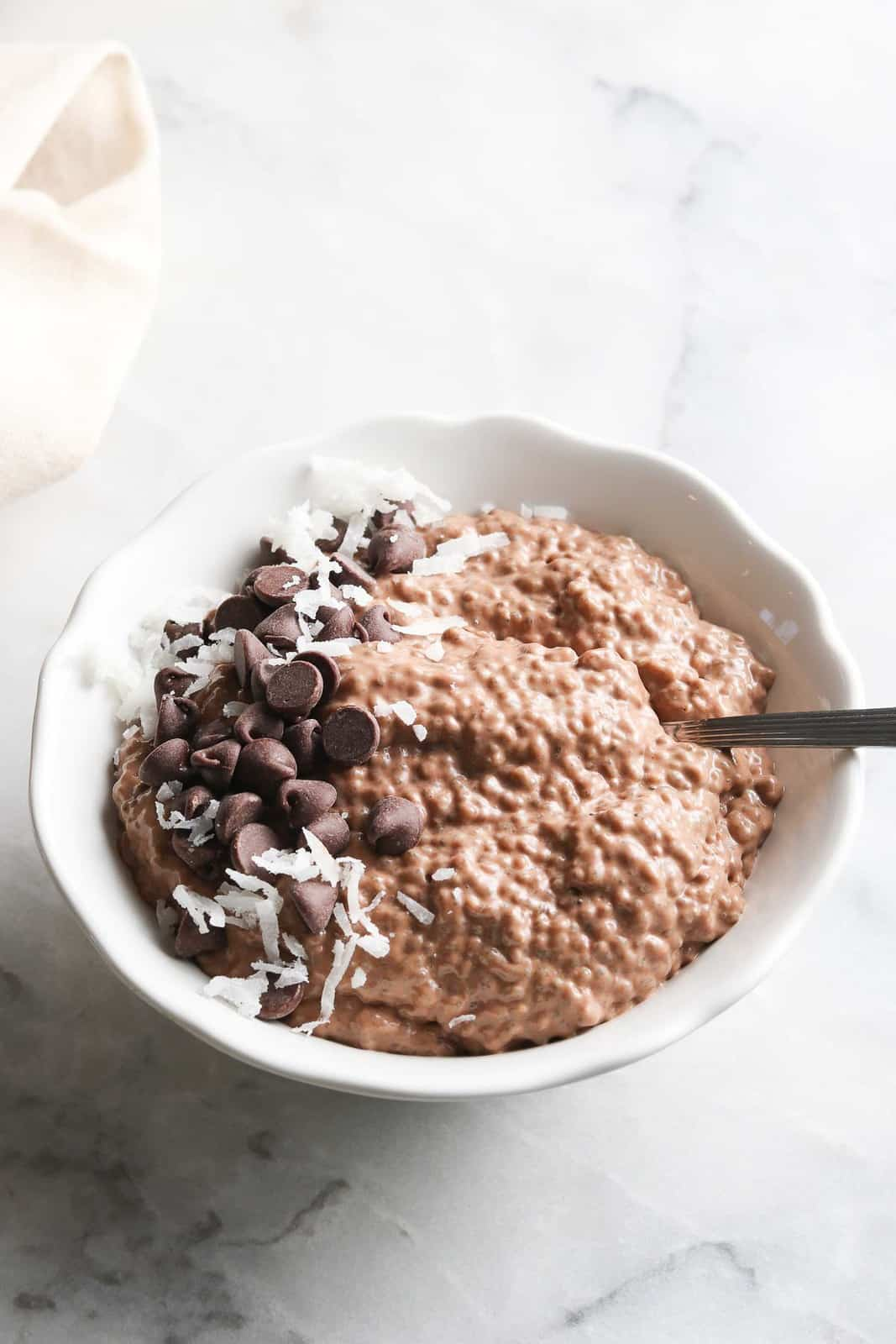Bowl of vegan chocolate chia seed pudding with chocolate chips