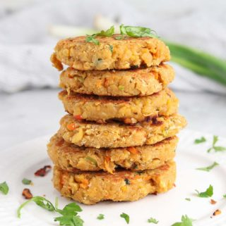 stack of vegan chickpea burger patties on a plate