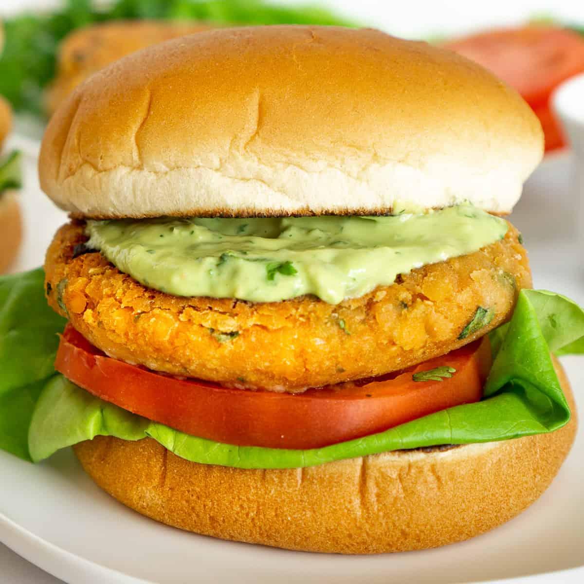 vegan lentil burger with creamy avocado sauce