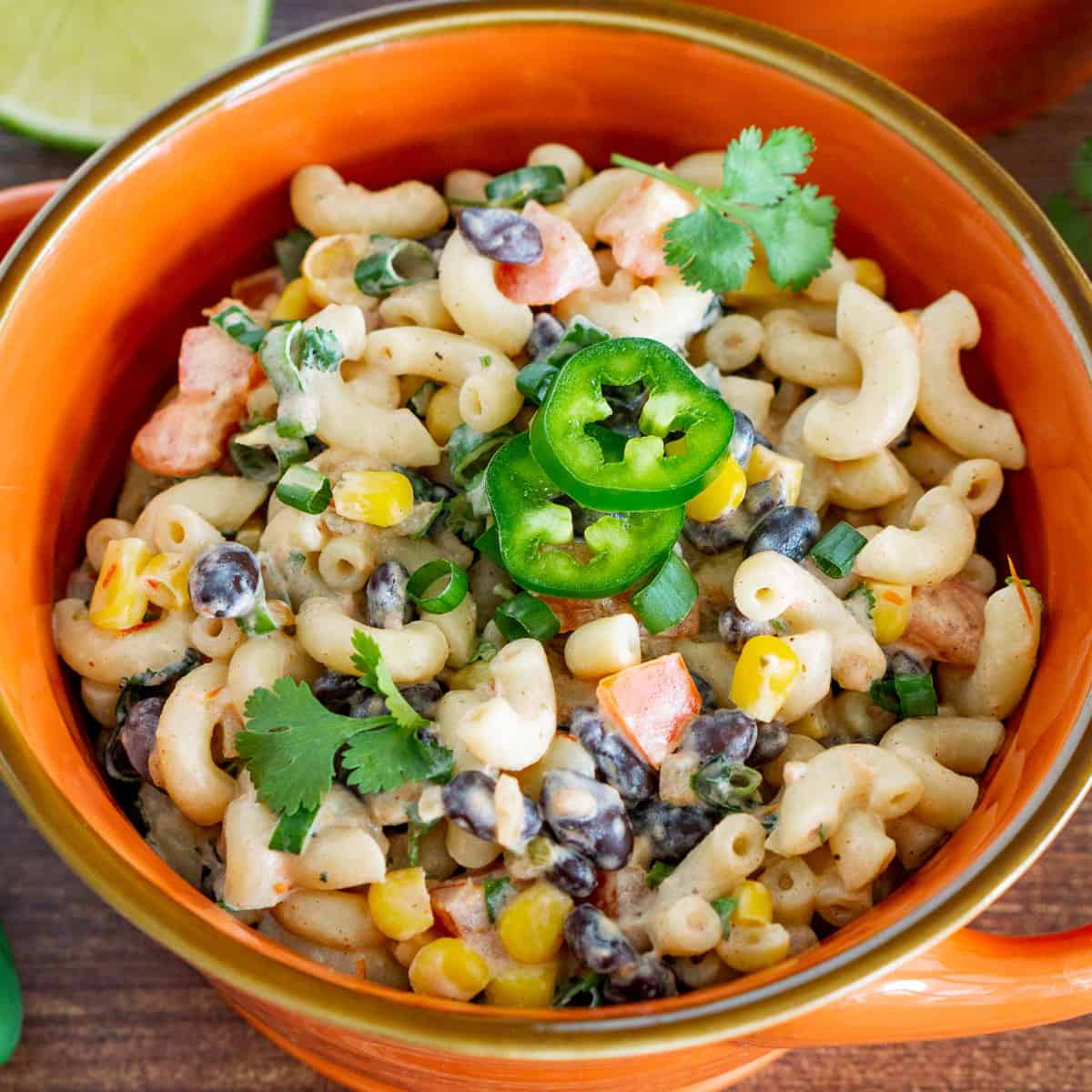 vegan mexican macaroni salad in a bowl garnished with jalapeno