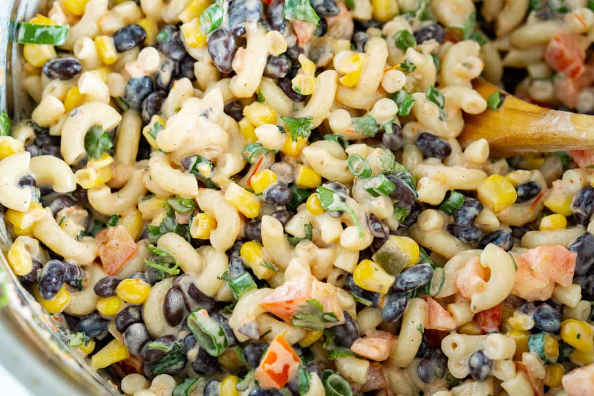 close up of creamy vegan mexican pasta salad in a bowl