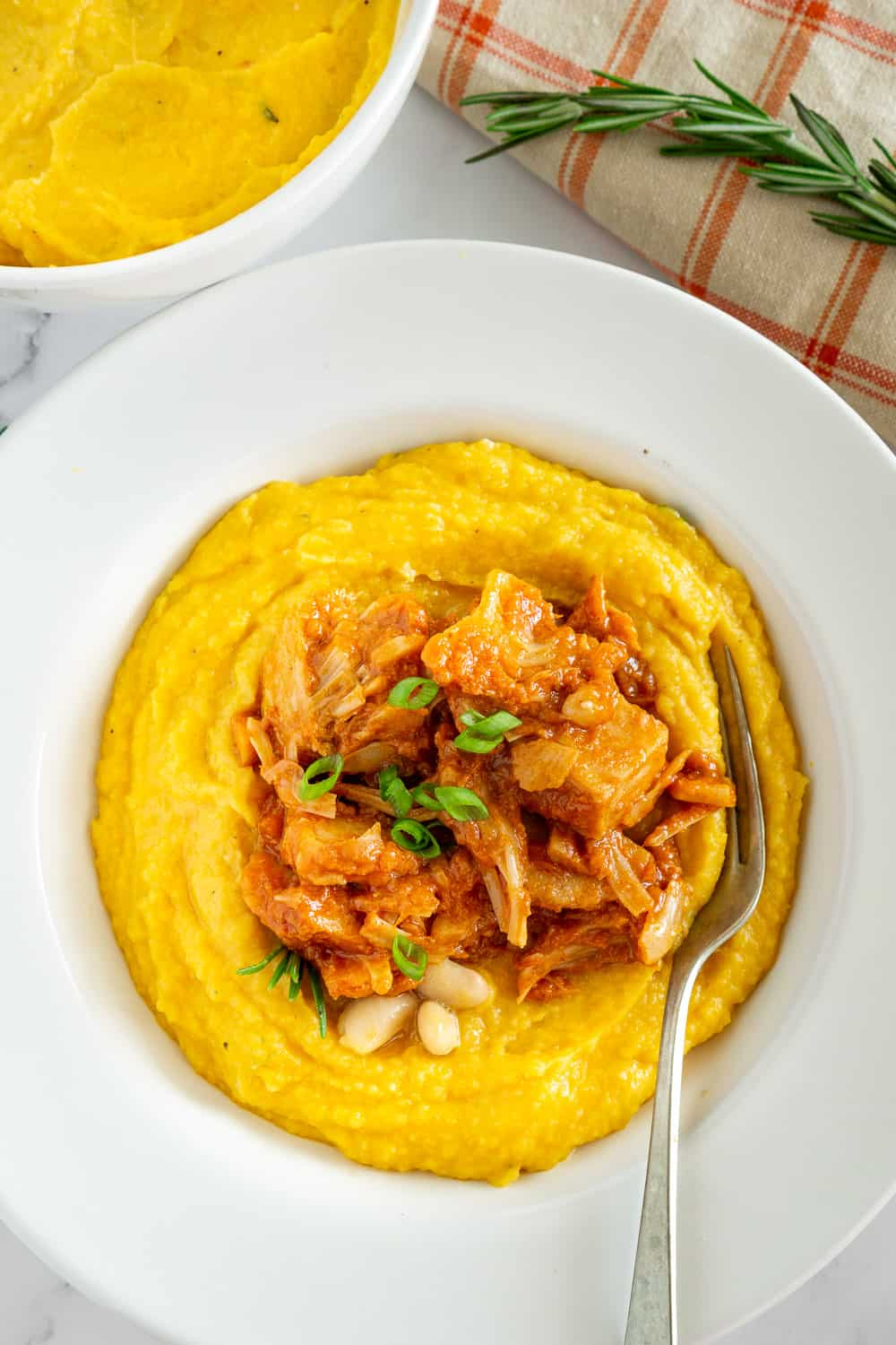 vegan white bean butternut squash mash topped with vegan bbq jackfruit