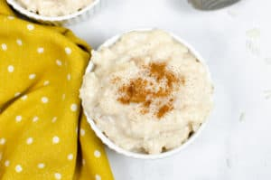 overhead image of cinnamon topped rice pudding in a ramekin