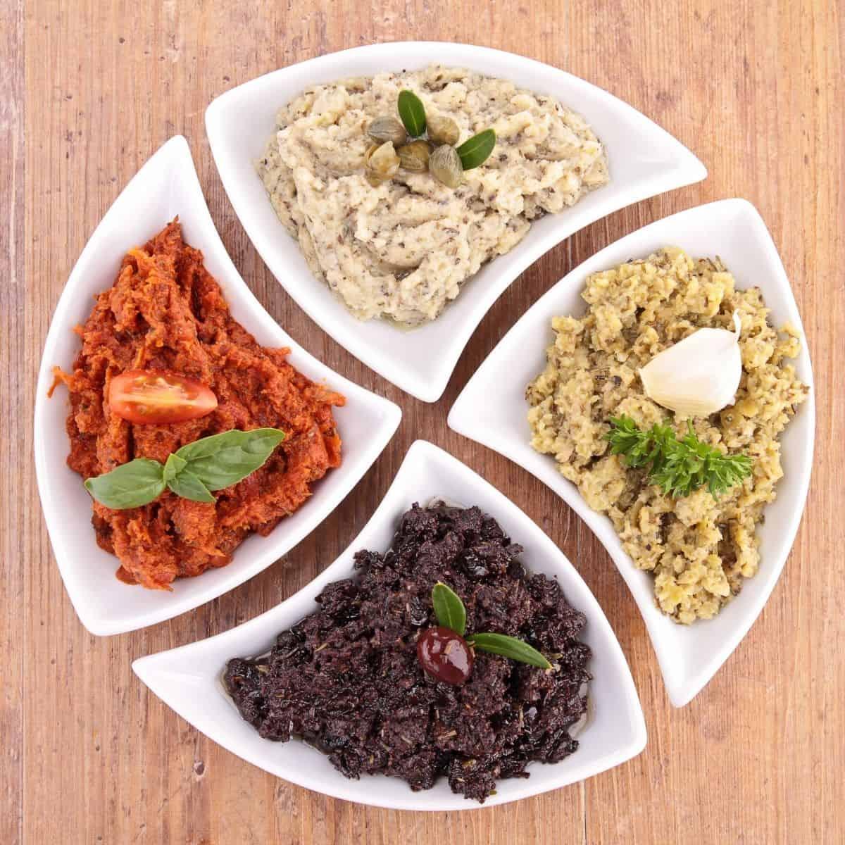 4 small plates of vegan tapenades