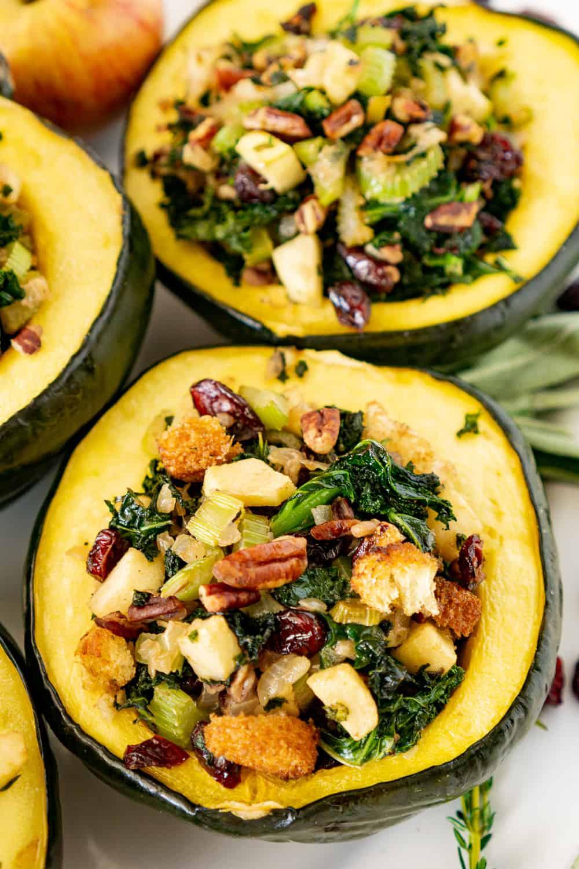 vegan stuffed acorn squash on a platter