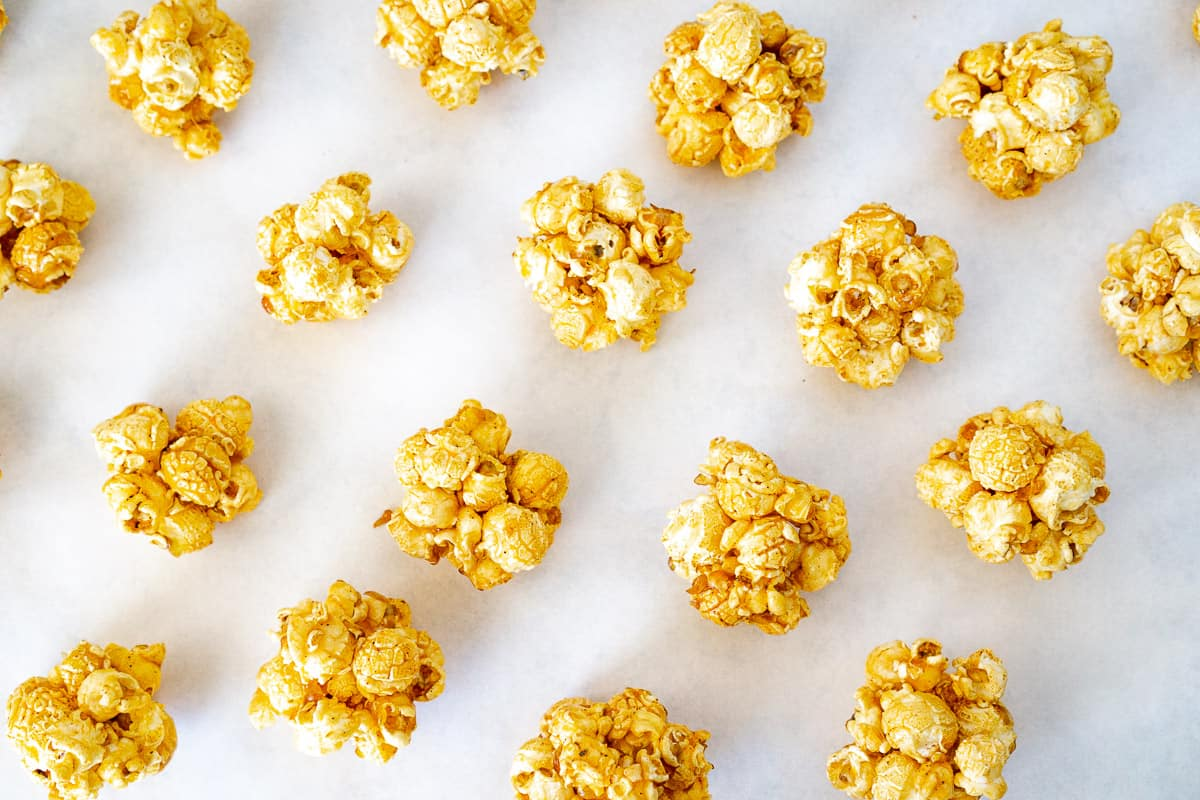 maple caramel popcorn balls on parchment paper