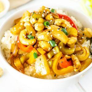 white bowl with cashew, celery, pineapple stir fry