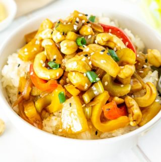 white bowl with cashew, celery, pineapple stir fry