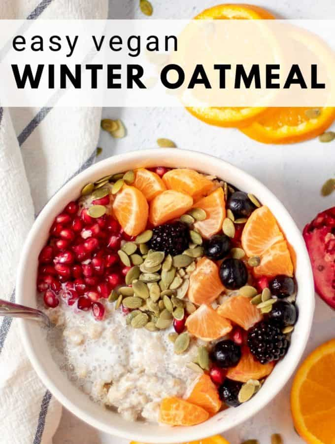 bowl of vegan oatmeal with pomegranate and fruit