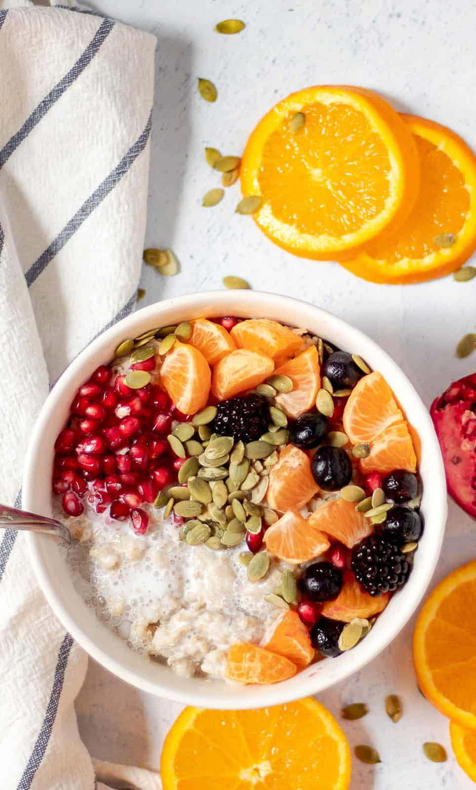 bowl of vegan oatmeal with almond butter and fruit