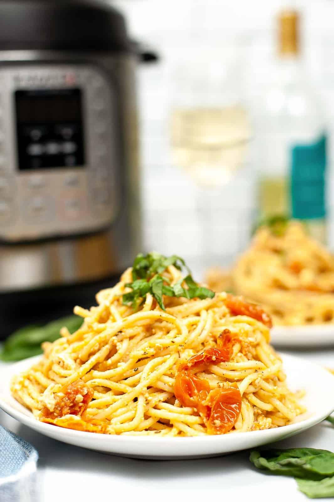 Plate of vegan tik tok pasta in front of an Instant Pot.
